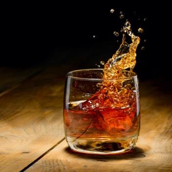 Whiskey Splashing In Glass