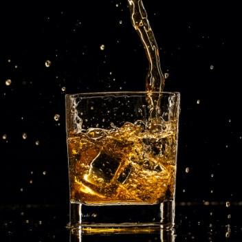 Whiskey Splashing Into Glass