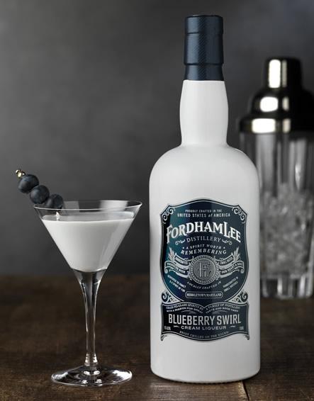 Blueberry Swirl Cream liquor bottle and cocktail
